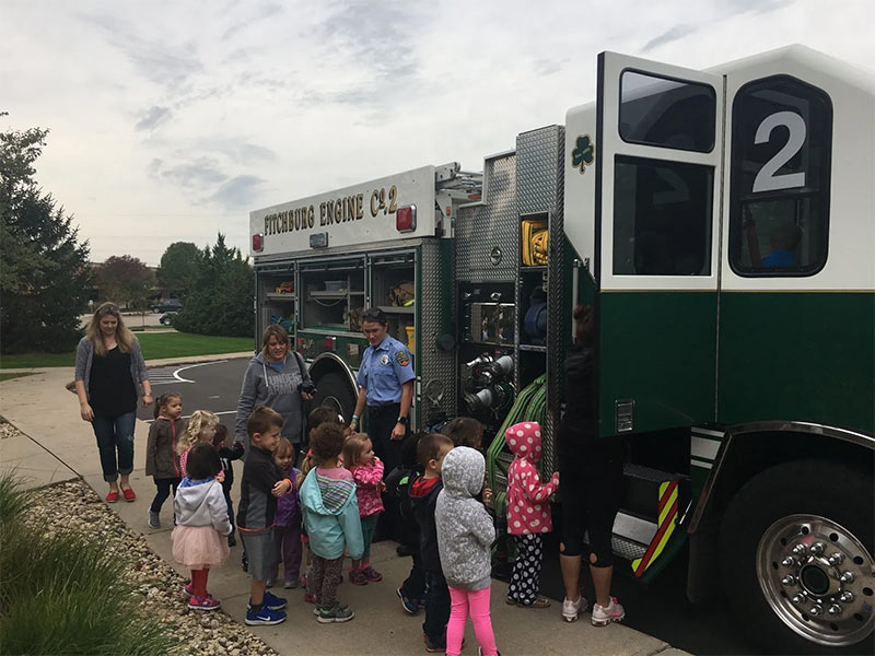 kids exploring fire truck