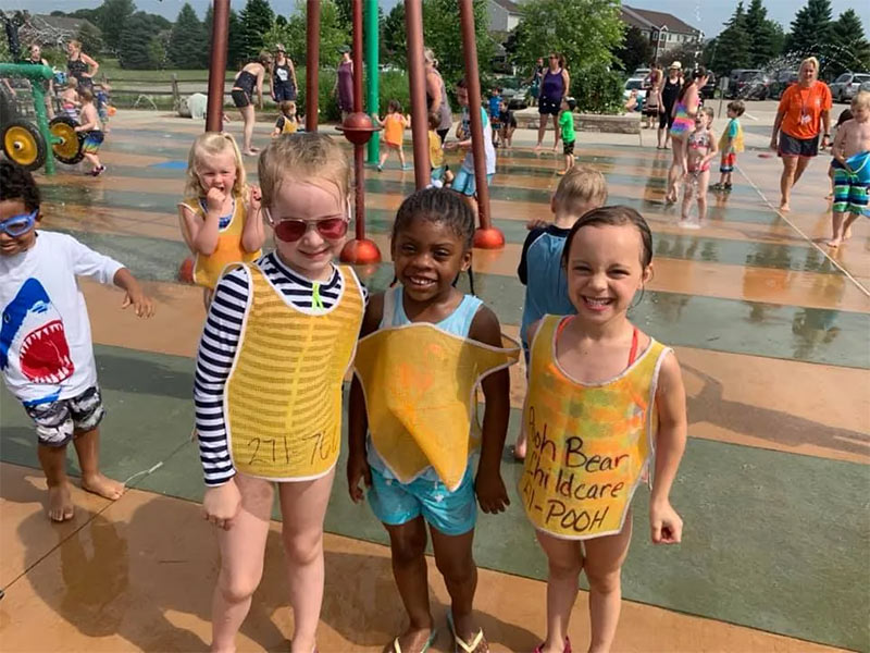 little girls at a splash pad