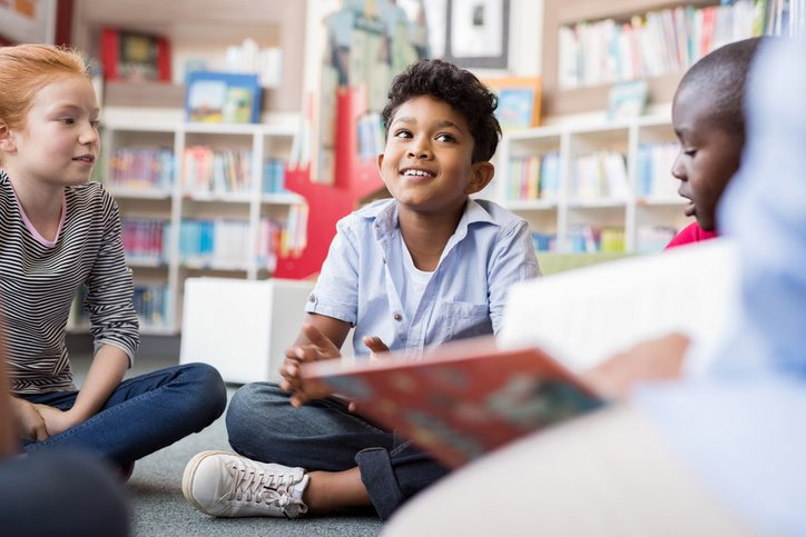 kids sitting in library